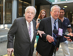 03 June  2015. New Orleans, Louisiana. <br /> Tom Benson, billionaire owner of the NFL New Orleans Saints, the NBA New Orleans Pelicans, various auto dealerships, banks, property assets and a slew of business interests leaves New Orleans Civil District Court with his attorney Phillip Whitman where they are attending a hearing to determine Benson's level of competency to manage his business empire. Benson changed his succession plans and  decided to leave the bulk of his estate to third wife Gayle, sparking a controversial fight over control of the Benson business empire.<br /> Photo©; Charlie Varley/varleypix.com