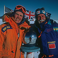 Will Steger and Victor Boyarsky pose at the ceremonial South Pole, halfway through the 1989-1990 Trans-Antarctica Expedition.