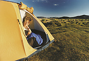 A trekker wakes up in Mongolia. Mongolia is an ideal destination for avid trekkers with unlimited opportunities...