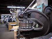 Some of the machinery in the plant, like this Rotex turret punch press, which dates to 1920s, has remained unchanged for many decades. This press is capable of punching holes in stainless steel sheet up to 2 inches in diameter.