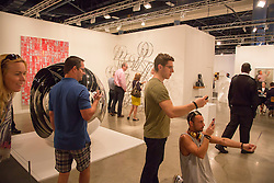 people and art inside Art Basel Miami