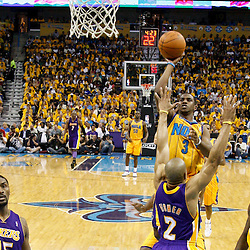 April 22, 2011; New Orleans, LA, USA; New Orleans Hornets point guard Chris Paul (3) shoots over Los Angeles Lakers point guard Derek Fisher (2) during the first half in game three of the first round of the 2011 NBA playoffs at the New Orleans Arena. The Lakers defeated the Hornets 100-86.   Mandatory Credit: Derick E. Hingle