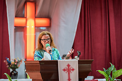 27 October 2019, Addis Ababa, Ethiopia: Rev. Dr Mari-Anna Auvinen shares words of greeting from a group of international visitors from the Lutheran World Federation during Sunday service at the Finfinne Oromo Mekane Yesus Congregation of the Ethiopian Evangelical Church Mekane Yesus. In a context where congregations did not use to be allowed to hold their services in any language but Amharic, the congregation today is one of some 60 Oromo speaking Mekane Yesus congregations in Addis Ababa.