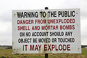 Ministry of Defence warning sign about unexploded shells and mortar bombs,  Salisbury Plain, Wiltshire, England, UK