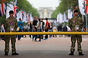 Soldiers of the British army stand guarding the entrance to  the volleyball venue in central London next to the IOC rings logo on day 4 of the London 2012 Olympic Games. A further 1,200 military personnel are being deployed to help secure the 2012 Olympics in London following the failure by security contractor G4S to provide enough private guards. The extra personnel have been drafted in amid continuing fears that the private security contractor's handling of the £284m contract remains a risk to the Games.