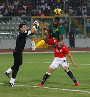 Photo: Steve Bond/Richard Lane Photography.<br />Egypt v Cameroun. Africa Cup of Nations. 22/01/2008.  Mohamadou Idrissou, (C) challanges over Wael Gomaa (R) as keeper Kamal El Hadary punches