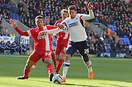 Bolton's Lukas Jutkiewicz is tackled by Blackburn's Adam Henley. Skybet championship match, Bolton Wanderers v Blackburn Rovers at the Reebok Stadium in Bolton, England on Saturday 1st March 2014.<br /> pic by David Richards, Andrew Orchard sports photography.