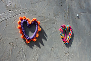 Knitted hearts on a wall in Moseley in Birmingham, United Kingdom. Its not known why these heart shapes have appeared, but they have done so in numbers on a boarded up building.
