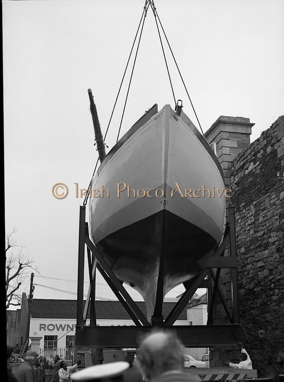 """The """"Asgard """" at Kilmainham Jail..1979..01.04.1979..04.01.1979..1st April 1979..The historic yacht """"Asgard"""" owned by Erskine Childers was brought to Kilmainham Jail,Dublin. The vessel had to be hoisted ,by crane,over the outer wall of the jail. It was placed as part of a future exhibition to be set up by The National Museum..Image shows the Asgard in position prior to the lift of the yacht over the wall."""