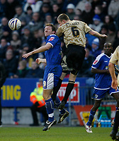 Photo: Steve Bond/Richard Lane Photography. Leicester City v Huddersfield Town. Coca Cola League One. 24/01/2009. Steve Howard (L) and Nathan Clarke (R) in the air