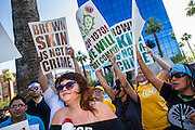 25 JUNE 2012 - PHOENIX, AZ:  ERIKA OVALLE leads chants in front of the Immigration and Customs Enforcement (ICE) offices in central Phoenix Monday. About 100 immigration supporters held a protest against ICE and continued deportations by the Obama administration. Protesters also celebrated the US Supreme Court decision to overturn most of SB1070, Arizona's tough anti-immigration law.     PHOTO BY JACK KURTZ
