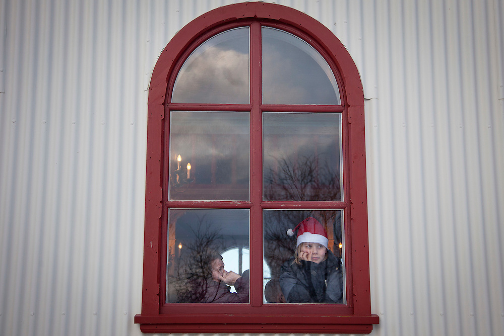 Christimas eve service at Kotstrandarkirkja to memorialize the dead, Iceland, December 24, 2013.