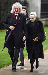 © Licensed to London News Pictures. 31/03/2018. Cambridge, UK. Former Queen guitarist RIAN MAY and his wife ANITA DOBSON, arrive for The funeral of Stephen Hawking at Church of St Mary the Great in Cambridge, Cambridgeshire. Professor Hawking, who was famous for ground-breaking work on singularities and black hole mechanics, suffered from motor neurone disease from the age of 21. He died at his Cambridge home in the morning of 14 March 2018, at the age of 76. Photo credit: Ben Cawthra/LNP