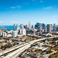 Aerial view to the east over I-95 flowing into the city core of Miami, Florida.