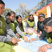 CAPTION: The Mahila Samakhya girls have split up into groups to draw the physical changes that occur in male and female bodies during adolescence. This is done pictorially, because this makes it easier for them to memorize. LOCATION: Mahila Samakhya, Ratu (block), Ranchi (city), Jharkhand (state), India. INDIVIDUAL(S) PHOTOGRAPHED: From left to right: Shobha Pareya, Ganga Purti, Sakro Hembrom, Hisee Murmu, Malti Laguri and Shobha Pareya.