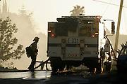 6 May 2009 - Santa Barbara, CA -  Fire teams battle the Jesusita fire as it burns near homes in the foothills of Santa Barbara, California. Photo Credit: Rod Rolle/Sipa Press,  21 August 2009-Santa Barbara, CA: