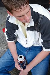 Teenage boy drinking.