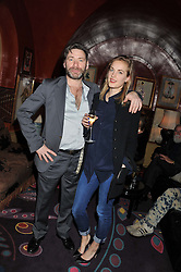 MAT COLLISHAW and POLLY MORGAN at a private view of work by Mat Collishaw - 'This is Not an Exit' held at Blaine/Southern, 4 Hanover Square, London on 13th February 2013.