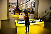 A visitor reads an information board at The Science Museum, London. The Science Museum was founded in 1857 with objects shown at the Great Exhibition of 1851. Today the Museum is world renowned for its historic collections, awe-inspiring galleries and inspirational exhibitions.
