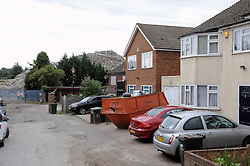 © Licensed to London News Pictures. 16/08/2015<br /> A mountain of waste still towers over local residents in St Pauls Cray,Orpington,Kent.  TODAY (16.08.2015)<br /> The residents of Cornwall Drive are still having to put up with a stinking smell,rats and fires coming from the  Waste4fuel site which is based at the end of the cul-de-sac.     The waste pile which is 40ft high can be clearly seen from Sidcup by-pass A20 and Crittalls Corner roundabout and is the first landmark visitors to the area are greeted with.<br /> <br /> <br /> (Byline:Grant Falvey/LNP)