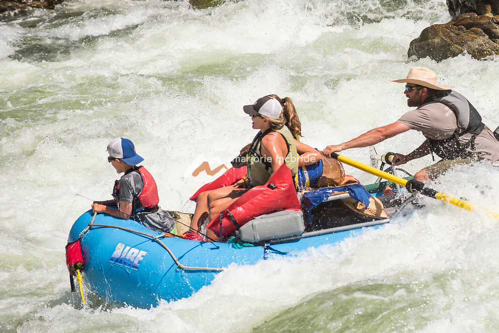 Family wet in white water rapid Snow Hole while rafting the Main Lower Salmon River, Hammer Creek to Hellar Bar, Idaho. MR