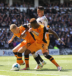 Michael Dawson (L) and Moses Odubajo of Hull City (C) in action against Thomas Ince of Derby County - Mandatory by-line: Jack Phillips/JMP - 14/05/2016 - FOOTBALL - iPro Stadium - Derby, England - Derby County v Hull City - Sky Bet Championship Play-Off Semi-Final First-Leg