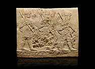 Hittite sculpted orthostats of Long Wall Limestone, Karkamıs, (Kargamıs), Carchemish (Karkemish), 900-700 BC. Anatolian Civilisations Museum, Ankara, Turkey<br /> <br /> Soldiers. Figure of three helmeted warriors. They have their shield in their back and their spear in their hand. The prisoners in their front are depicted as small. The lower part of the orthostat is decorated with wring / braiding motifs.<br /> <br /> On a black background. .<br />  <br /> If you prefer to buy from our ALAMY STOCK LIBRARY page at https://www.alamy.com/portfolio/paul-williams-funkystock/hittite-art-antiquities.html  - Type  Karkamıs in LOWER SEARCH WITHIN GALLERY box. Refine search by adding background colour, place, museum etc.<br /> <br /> Visit our HITTITE PHOTO COLLECTIONS for more photos to download or buy as wall art prints https://funkystock.photoshelter.com/gallery-collection/The-Hittites-Art-Artefacts-Antiquities-Historic-Sites-Pictures-Images-of/C0000NUBSMhSc3Oo