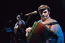 "© Licensed to London News Pictures. 05/09/2013. London, England. Pictured: Adrian Stout at back and Martyn Jacques. ""Rime of the Ancient Mariner"" - a 90-minute musical adaptation of Samuel Taylor Coleridge' greatest work - is performed by ""The Tiger Lillies"" collaborating with American visual artist Mark Holthusen to create a show that is between a movie and a concert. The Tiger Lillies are Martyn Jacques (vocals, accordion, piano), Adrian Stout (bass, vocals) and Mike Pickering (drums) and will be performing at the Queen Elizabeth Hall, London, from 5 to 8 September 2013. Photo credit: Bettina Strenske/LNP"