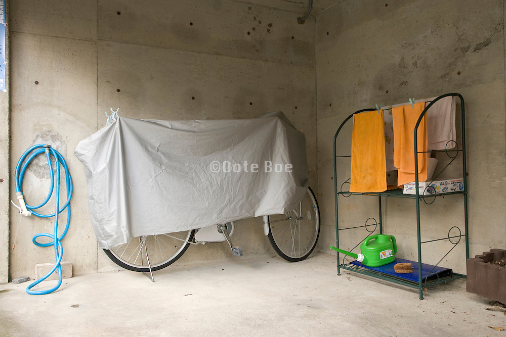 bicycle covered with a cloth against dust Japan