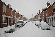 People on a street of terraced housing in Kings Heath head out during heavy snow fall on Sunday 10th December 2017 in Birmingham, United Kingdom. Deep snow arrived in much of the UK, closing roads and making driving treacherous, while many people simply enjoyed the weather.