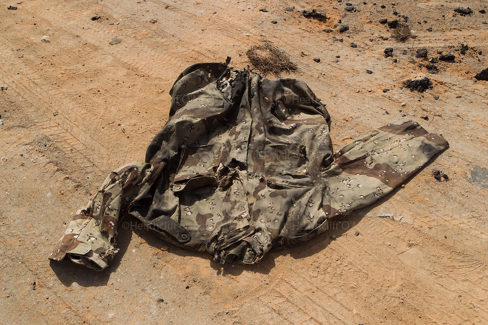 A torn and soiled military jacket lies on the ground near to Libyan Army armoured vehicles that were destroyed by NATO airstrikes in the city of Ajdabiyah...Ajdabiyah 26 March 2011