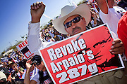 Feb. 28, 2009 -- PHOENIX, AZ: A man holds up sign calling for the Department of Homeland Security to revoke the Maricopa County Sheriff's authority under the 287g program to investigate immigration crimes. Thousands of people in Phoenix, AZ, protested against Maricopa County Sheriff Joe Arpaio's immigration policies. Arpaio has polarized the community by conducting raids against illegal immigrants in businesses and neighborhoods in the Phoenix area that are frequented by Hispanics. Members of Congress have written to Attorney General Eric Holder and asked him to investigate Arpaio for human rights violations. Arpaio claims he has authority under the Department of Homeland Security's 287g program to investigate and arrest illegal immigrants.     Photo By Jack Kurtz