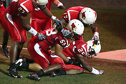 26 September 2009: Ten yards behind the goal post, Chris Garrett gets smothered by Doni Phelps(58), Jermaine Malcolm(27) and Paul Wright (17) after Garrett intercepts a Jackrabbit pass and returns it for a touchdown. in a game which the South Dakota State Jackrabitts jump past the Illinois State Redbirds 38 - 17 at Hancock Stadium on campus of Illinois State University in Normal Illinois