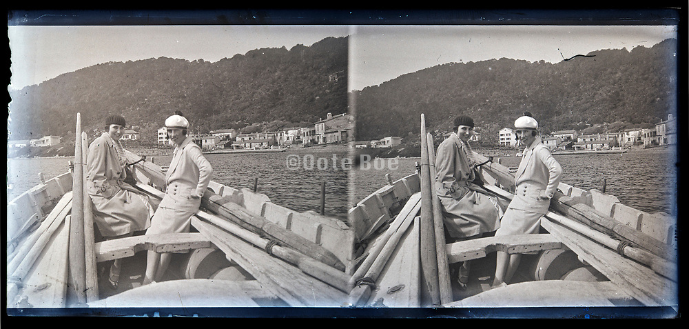vacationing with boat on the water circa 1920s