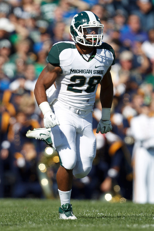 Michigan State linebacker Denicos Allen (#28) in action during NCAA football game between Notre Dame and Michigan State.  The Notre Dame Fighting Irish defeated the Michigan State Spartans 31-13 in game at Notre Dame Stadium in South Bend, Indiana.