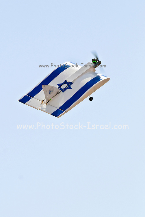 Israel, Massada Air Strip, the international radio controlled model aircraft competition June 27 2009. A model aeroplane in the shape of the Israeli flag