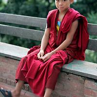 Asia, Nepal, Kathmandu. Younmg boy monk.