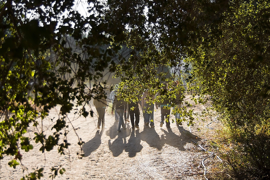Teenagers walk together outside the village of San Antonio Necua, Baja California Norte, Mexico, an urban youth group on a field trip from Tecate to learn about Kumiai indian culture and develop a deeper appreciation for the natural world.