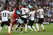 Cheikhou Kouyate of West Ham United attempts to head the ball past Goalkeeper Silviu Lung of Astra Giurgiu. UEFA Europa league, 1st play off round match, 2nd leg, West Ham Utd v Astra Giurgiu at the London Stadium, Queen Elizabeth Olympic Park in London on Thursday 25th August 2016.<br /> pic by John Patrick Fletcher, Andrew Orchard sports photography.