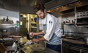 Executive chef Chris Marchino works in the kitchen Tuesday, July 29, 2014 at Spiaggia. (Brian Cassella/Chicago Tribune) B583898846Z.1 <br /> ....OUTSIDE TRIBUNE CO.- NO MAGS,  NO SALES, NO INTERNET, NO TV, CHICAGO OUT, NO DIGITAL MANIPULATION...