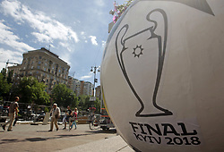 May 18, 2018 - Kiev, Ukraine - Ukrainians walk past flower bed with the logo the UEFA Champions League final in central Kiev, Ukraine, 18 May, 2018. The football UEFA Champions League final match between Real Madrid and Liverpool FC next May 26 at the NSC Olimpiyskiy Stadium. (Credit Image: © Str/NurPhoto via ZUMA Press)