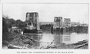 the Big Black River Bridge burnt by the retreating Confederates. from the book ' The Civil war through the camera ' hundreds of vivid photographs actually taken in Civil war times, sixteen reproductions in color of famous war paintings. The new text history by Henry W. Elson. A. complete illustrated history of the Civil war