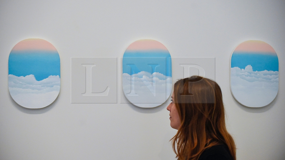 """© Licensed to London News Pictures. 13/02/2020. LONDON, UK. A staff member poses next to """"LHR-BEY British Airways 09.12.18"""", 2020, by Andrew Maughan.  Preview of """"Premiums Interim Exhibition"""", an exhibition of new work by second year students in the Royal Academy Schools.   Works by 16 artists are on show 13 February to 11 March 2020 at the Royal Academy of Arts in Piccadilly by artists at the interim point of their postgraduate study at the UK's longest established art school.  Photo credit: Stephen Chung/LNP"""