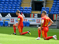 Football - 2020 / 2021 UEFA Nations League - Group B4 - Wales vs Bulgaria<br />      <br /> Gareth Bale of Wales & Connor Roberts v take the knee<br /> in a match played with no crowd due to Covid 19 coronavirus emergency regulations, in an almost empty ground, at the Cardiff City Stadium.<br /> <br /> COLORSPORT/WINSTON BYNORTH