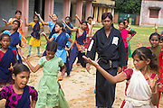 Munna Kumar, 40, the local Karate instructor is walking among his girl students during a class in Algunda village, pop. 1000, Giridih District, rural Jharkhand, India.