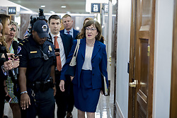 October 3, 2018 - Washington, District of Columbia, United States - Reporters shout questions to Senator SUSAN COLLINS (R-ME), Chairwoman of the Senate Special Committee on Ageing, regarding the confirmation of BRETT KAVANAUGH to the Supreme Court (Credit Image: © Douglas Christian/ZUMA Wire)