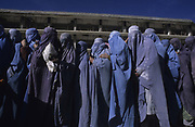 Kabul. Afghanistan. Women, many of them widows, queue to receive food aid from Care International.