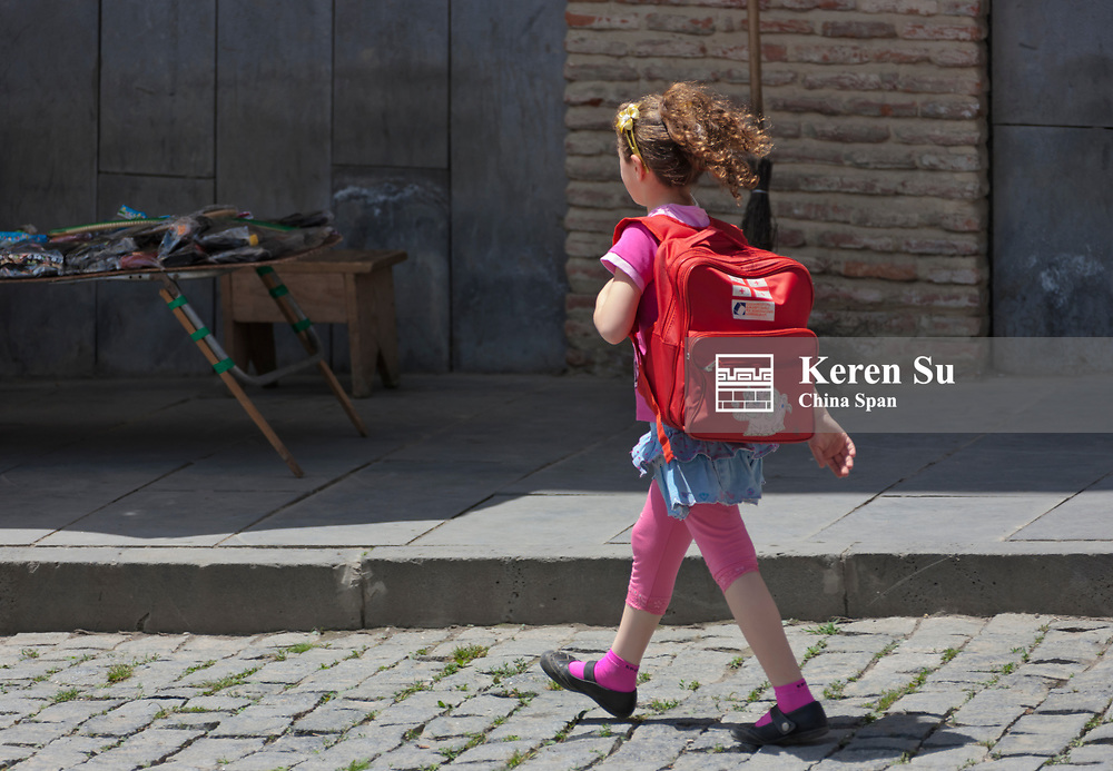 Girl walking on the street, Sighnaghi, Georgia
