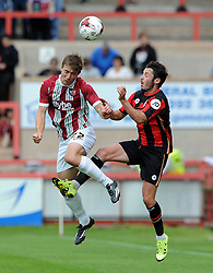 Exeter City's David Wheeler challenges for the aerial ball with Bournemouth's Adam Smith. - Photo mandatory by-line: Harry Trump/JMP - Mobile: 07966 386802 - 18/07/15 - SPORT - FOOTBALL - Pre Season Fixture - Exeter City v Bournemouth - St James Park, Exeter, England.