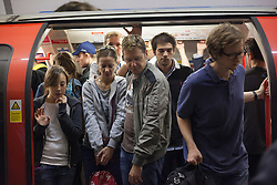 © licensed to London News Pictures. London, UK 31/07/2012. People trying to make room in a packed Central Line train as the line operated with severe delays and temporarily lost its connection to Stratford (Olympic Park) on 31/07/12. Photo credit: Tolga Akmen/LNP